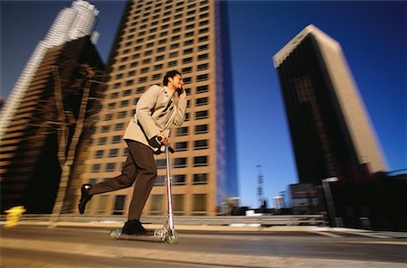 peter griffith - Businessman Using Scooter and Cell Phone by Office Towers Los Angeles, California, USA Stock Photo - Rights-Managed, Code: 700-00082219