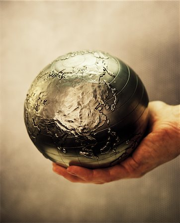 Globe in Palm of Hand Pacific Rim Stock Photo - Rights-Managed, Code: 700-00083087