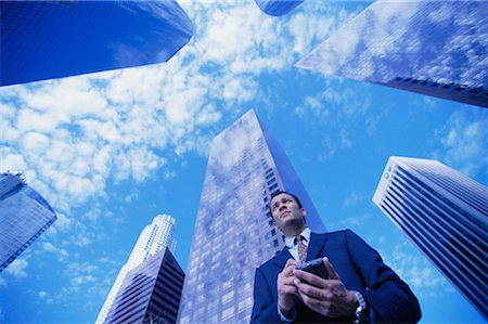 peter griffith - Businessman Using Electronic Organizer by Office Towers Los Angeles, California, USA Stock Photo - Rights-Managed, Code: 700-00083386