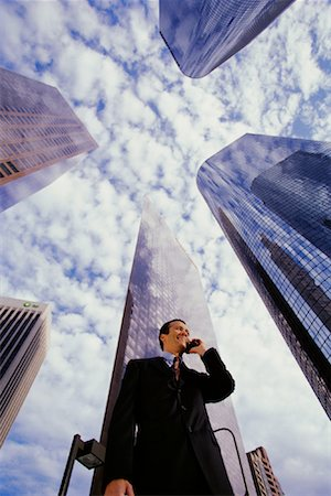 peter griffith - Businessman Using Cell Phone By Office Towers Los Angeles, California, USA Stock Photo - Rights-Managed, Code: 700-00083397