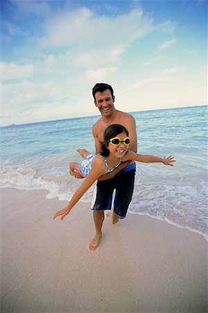 peter griffith - Father and Daughter in Swimwear Father Holding Daughter in Air on Beach Stock Photo - Rights-Managed, Code: 700-00083452