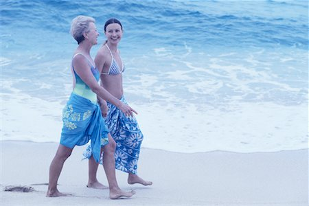 peter griffith - Mature Mother and Daughter Walking on Beach Stock Photo - Rights-Managed, Code: 700-00083482