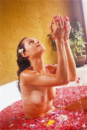 Woman in Bathtub with Flower Petals Stock Photo - Rights-Managed, Code: 700-00083745
