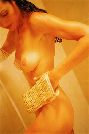 Woman in Shower, Using Loofah Mitt Stock Photo - Rights-Managed, Code: 700-00083762