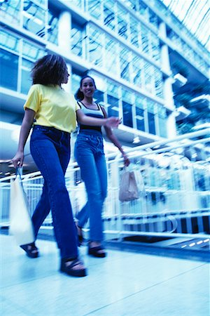 Young Women Walking Through Mall Stock Photo - Rights-Managed, Code: 700-00096870