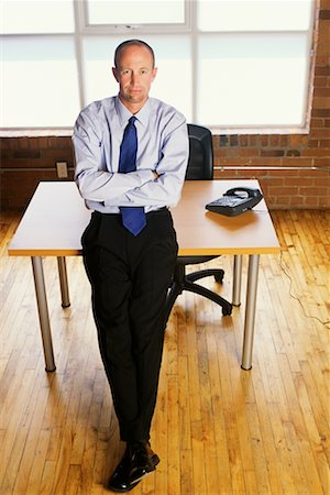 peter griffith - Businessman Leaning Against Desk Stock Photo - Rights-Managed, Code: 700-00093355