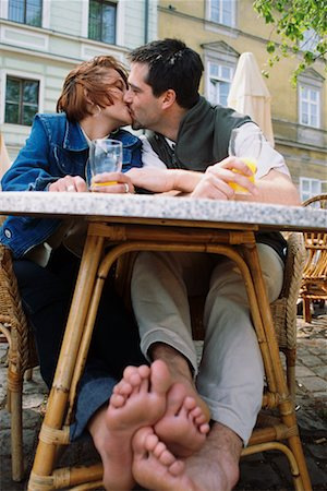 Couple Kissing at Outdoor Cafe Stock Photo - Rights-Managed, Code: 700-00158471