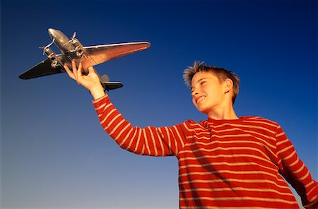 pre-teen boy models - Boy With Toy Airplane Stock Photo - Rights-Managed, Code: 700-00151901
