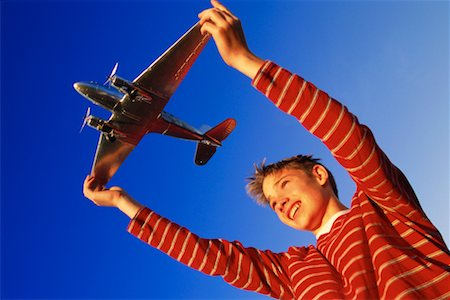 pre-teen boy models - Boy With Toy Airplane Stock Photo - Rights-Managed, Code: 700-00151902