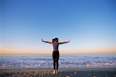 Woman Stretching on the Beach Stock Photo - Rights-Managed, Code: 700-00152471