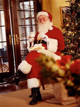 Santa Claus Eating Cookies Stock Photo - Rights-Managed, Code: 700-00153307