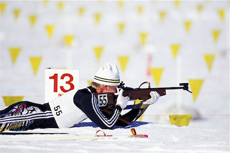 Biathlon Athlete Lying Down Shooting at Target Stock Photo - Rights-Managed, Code: 700-00165884