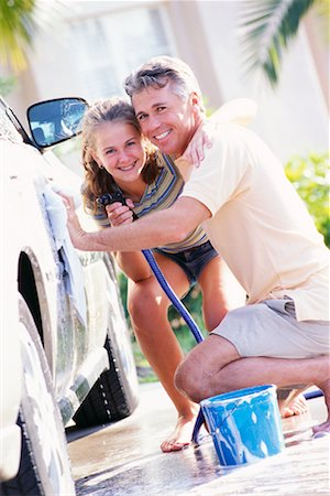 Father and Daughter Washing Car Stock Photo - Rights-Managed, Code: 700-00168083