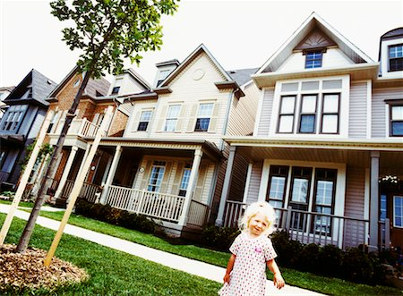 Girl in Front of Houses Stock Photo - Rights-Managed, Code: 700-00162449