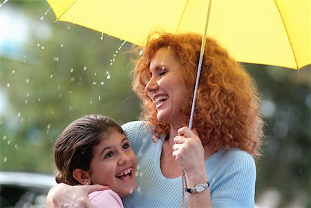 preteens shower - Mother and Daughter with Umbrella in the Rain Stock Photo - Rights-Managed, Code: 700-00177533