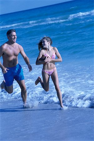 Father and Daughter Running On Beach Stock Photo - Rights-Managed, Code: 700-00181651