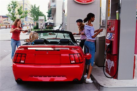 Teenage Girls Putting Gas in Car Stock Photo - Rights-Managed, Code: 700-00183106