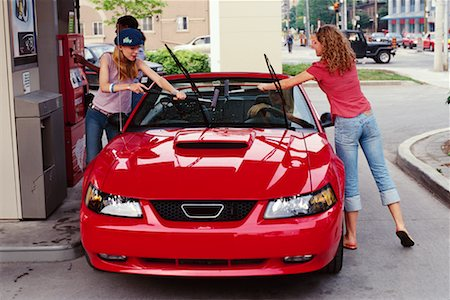 Teenage Girls Putting Gas in Car Stock Photo - Rights-Managed, Code: 700-00183107