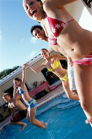 Teenagers Jumping into Pool Stock Photo - Rights-Managed, Code: 700-00183144