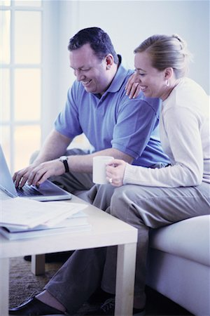 Couple Playing Bills Online Stock Photo - Rights-Managed, Code: 700-00194707