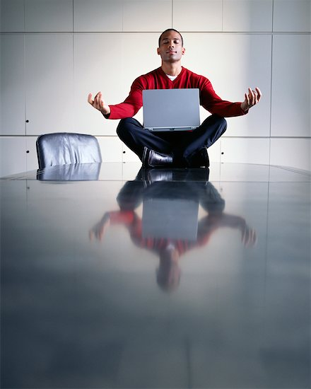 Man Doing Yoga in Office Boardroom Stock Photo - Premium Rights-Managed, Artist: Noel Hendrickson, Image code: 700-00195515