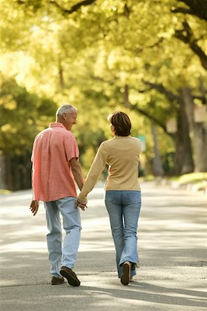 peter griffith - Couple Walking down Country Road Stock Photo - Rights-Managed, Code: 700-00195822