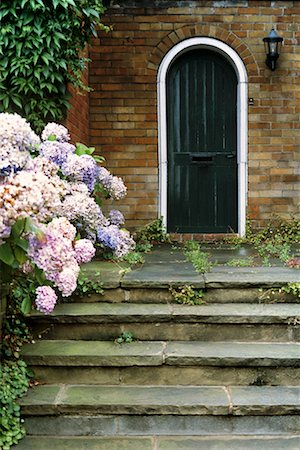 Door with Porch and Flowers Stock Photo - Rights-Managed, Code: 700-00196729