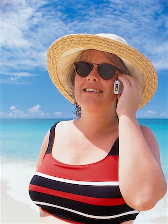 Woman Using Cellular Phone on Beach Grande Case, St. Martin, France Stock Photo - Rights-Managed, Code: 700-00197131