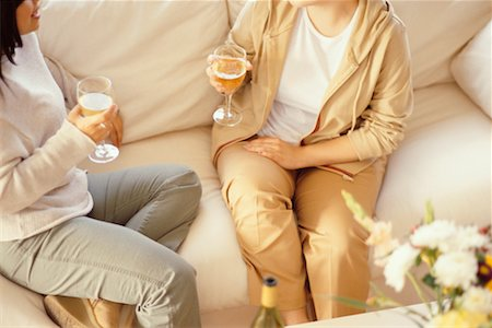 Women Sitting on Sofa Drinking Wine Stock Photo - Rights-Managed, Code: 700-00193397