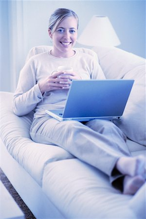 Woman Using Laptop at Home Stock Photo - Rights-Managed, Code: 700-00193418