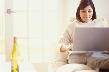 fat italian woman - Woman on Sofa Using Laptop Stock Photo - Rights-Managed, Code: 700-00193439