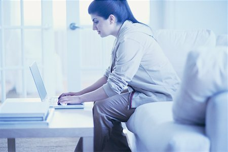 fat italian woman - Woman on Sofa Using Laptop Stock Photo - Rights-Managed, Code: 700-00193447