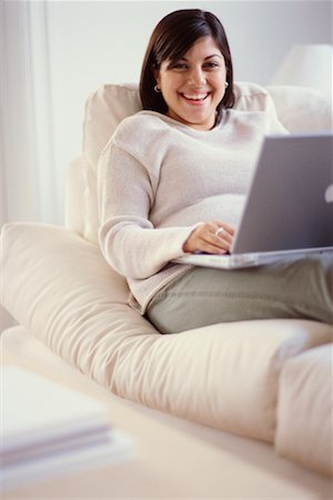 fat italian woman - Woman on Sofa Using Laptop Stock Photo - Rights-Managed, Code: 700-00193440