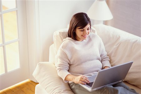 fat italian woman - Woman on Sofa Using Laptop Stock Photo - Rights-Managed, Code: 700-00193442