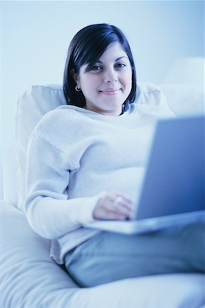 fat italian woman - Woman on Sofa Using Laptop Stock Photo - Rights-Managed, Code: 700-00193443