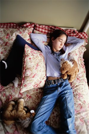 Teenage Girl Lying on Bed Stock Photo - Rights-Managed, Code: 700-00268960