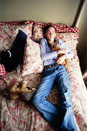 Teenage Girl Lying on Bed Stock Photo - Rights-Managed, Code: 700-00268961