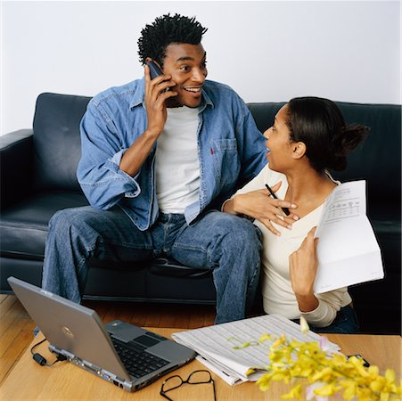Couple Sitting on Sofa Discussing Their Personal Finances Stock Photo - Rights-Managed, Code: 700-00269446