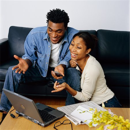 Couple Using Laptop to Check Their Personal Finances Stock Photo - Rights-Managed, Code: 700-00269452