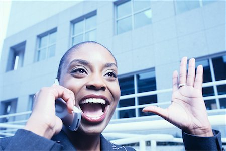 Businesswoman Using Cell Phone Stock Photo - Rights-Managed, Code: 700-00270119