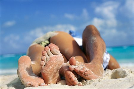 Couple Lying on Beach Stock Photo - Rights-Managed, Code: 700-00280838
