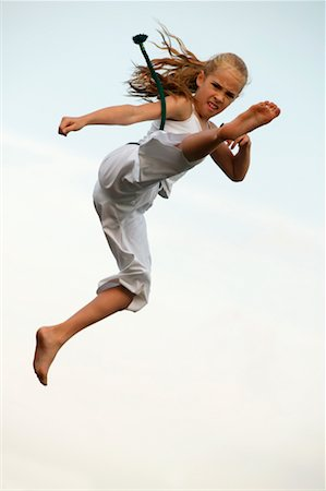 Girl doing a Karate Kick Stock Photo - Rights-Managed, Code: 700-00328209
