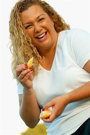 Woman Eating Orange Stock Photo - Rights-Managed, Code: 700-00342248