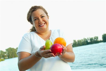 Woman Holding Fruit Stock Photo - Rights-Managed, Code: 700-00342243