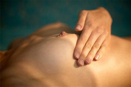 Woman Performing Self Breast Exam Stock Photo - Rights-Managed, Code: 700-00342367