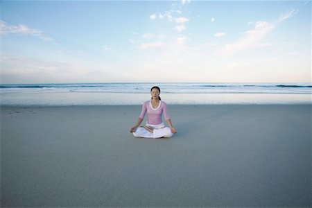 peter griffith - Woman Doing Yoga on Beach Stock Photo - Rights-Managed, Code: 700-00367880