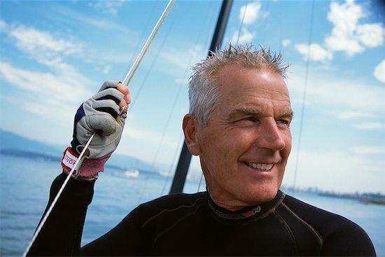 Man on Boat Stock Photo - Premium Rights-Managed, Artist: Jeremy Maude, Image code: 700-00378307
