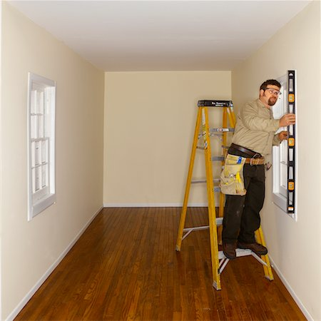 Man Working on House Stock Photo - Rights-Managed, Code: 700-00404021