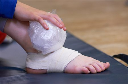 Dancer Holding Ice Pack on Foot Stock Photo - Rights-Managed, Code: 700-00425851