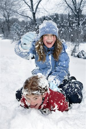 Two Girls Playing in the Snow Stock Photo - Rights-Managed, Code: 700-00458157
